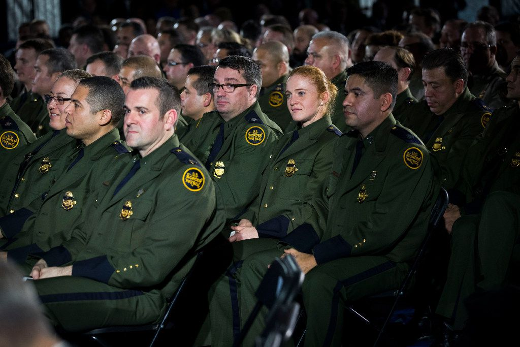 Border Patrol agents listen to President Donald Trump in Washington, D.C. speak of constructing a border wall, in this file photo from January. (Doug Mills/The New York Times)