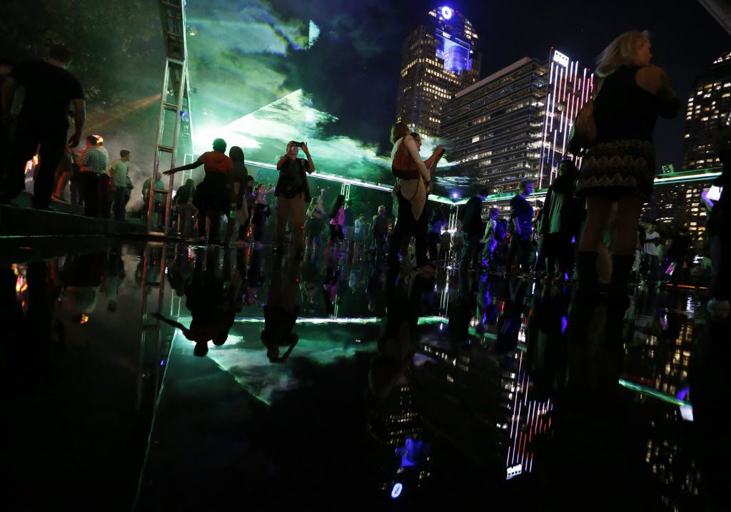 People take in the sights in the Dallas Arts District during Aurora on Friday, October 16, 2015.