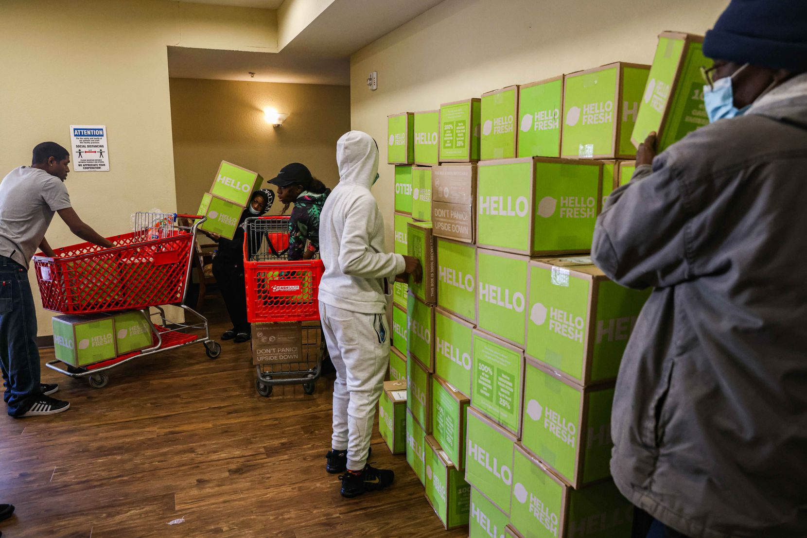 Much-needed food was piling up as volunteers brough boxes of meals into the Lakewest Senior Housing complex in West Dallas on Saturday, Feb. 20, 2021.