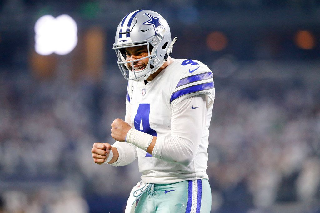 FILE - Cowboys quarterback Dak Prescott (4) reacts after receiver Michael Gallup (13) scored a second-quarter touchdown in the NFC wild-card game against Seattle at AT&T Stadium in Arlington on Saturday, Jan. 5, 2019. (Tom Fox/The Dallas Morning News)