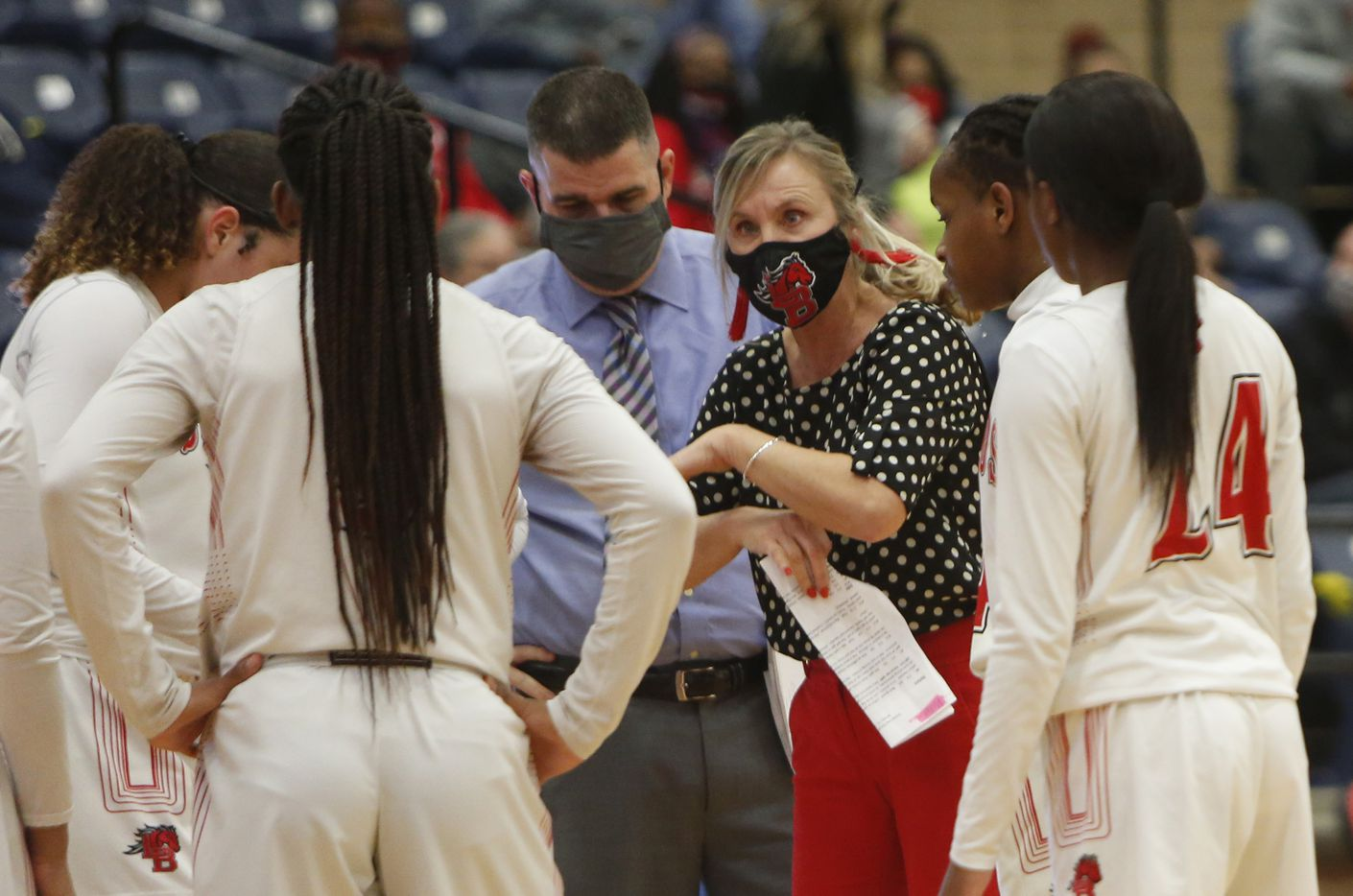 Mansfield Legacy head coach Michelle Morris speaks with her players during a timeout during first half action against Mansfield Timberview. The two teams played their District 8-5A girls basketball game at Mansfield Legacy High school on January 22 , 2021. (Steve Hamm/ Special Contributor)