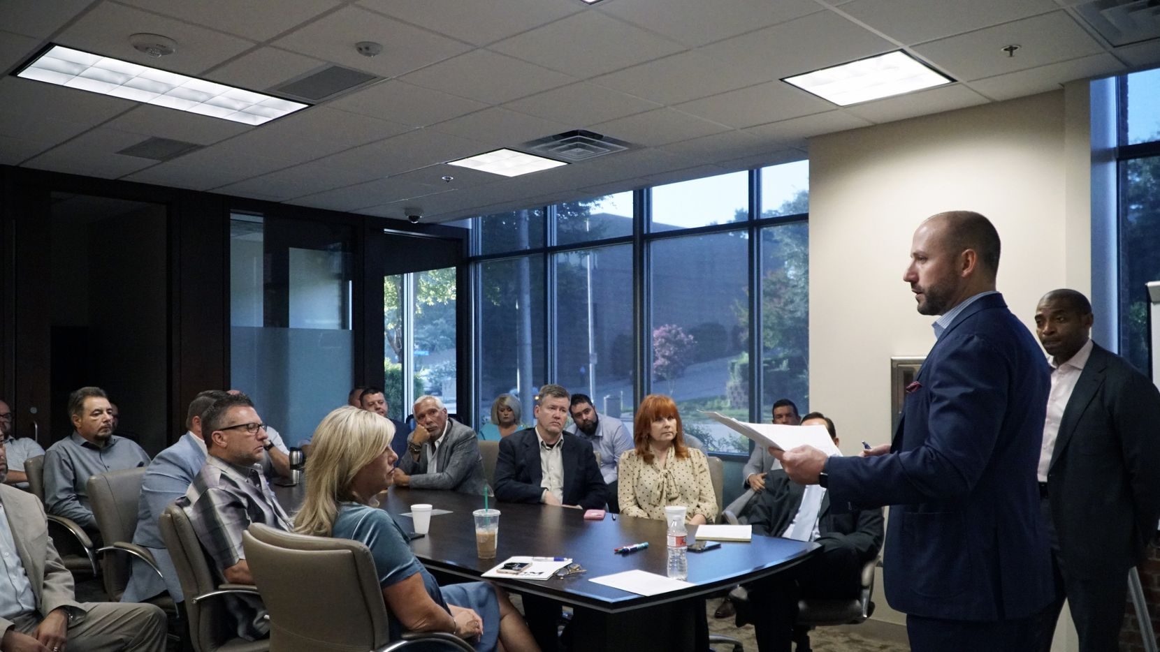 Chase Kennemer, president of D&M Leasing Fort Worth, gives direction during the morning sales meeting at D&M Leasing office in Fort Worth.