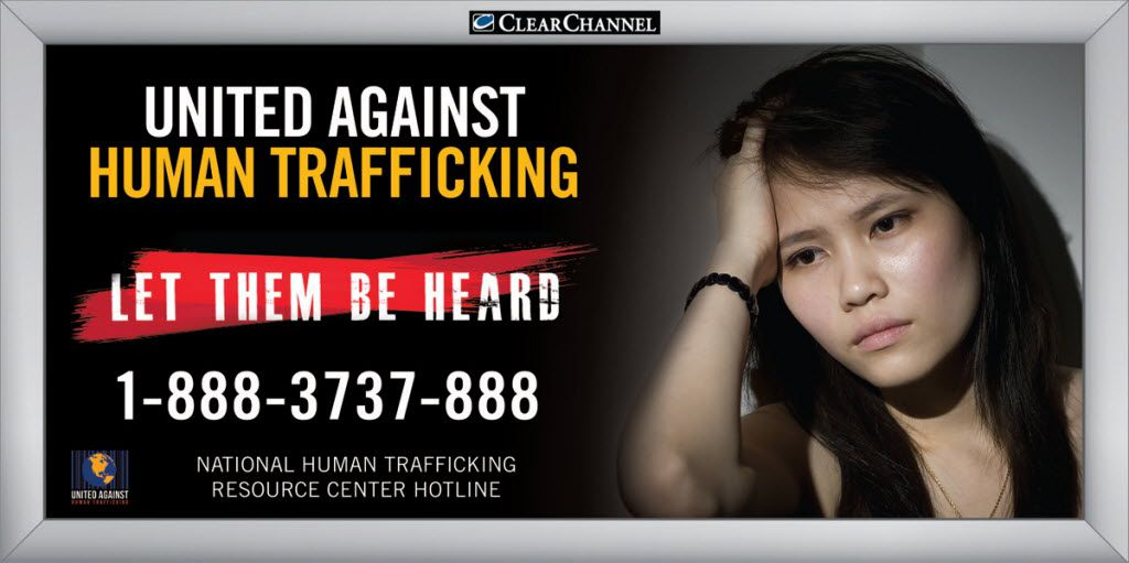 A United Against Human Trafficking billboard shows the phone hotline number for the national human trafficking resource center.