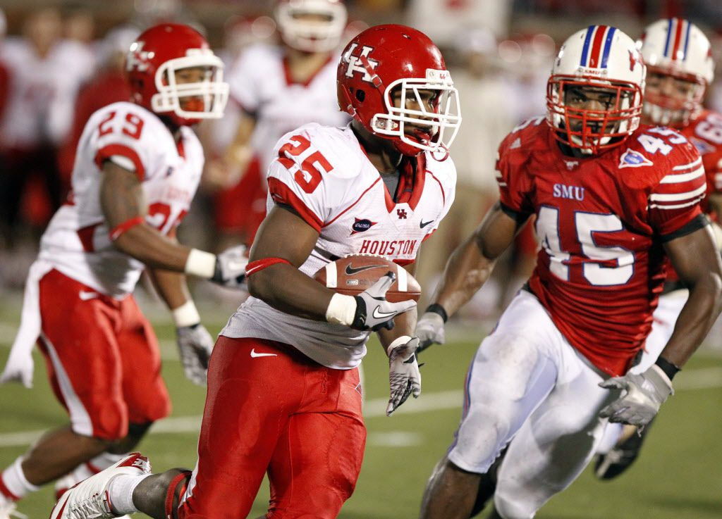 Houston Cougars running back Bryce Beall (25) runs for a first down during fourth quarter action in the Mustangs' 45-20 loss during first quarter NCAA C-USA football action between SMU and Houston at Ford Stadium at SMU in University Park on October 23, 2010. (John F. Rhodes / The Dallas Morning News)