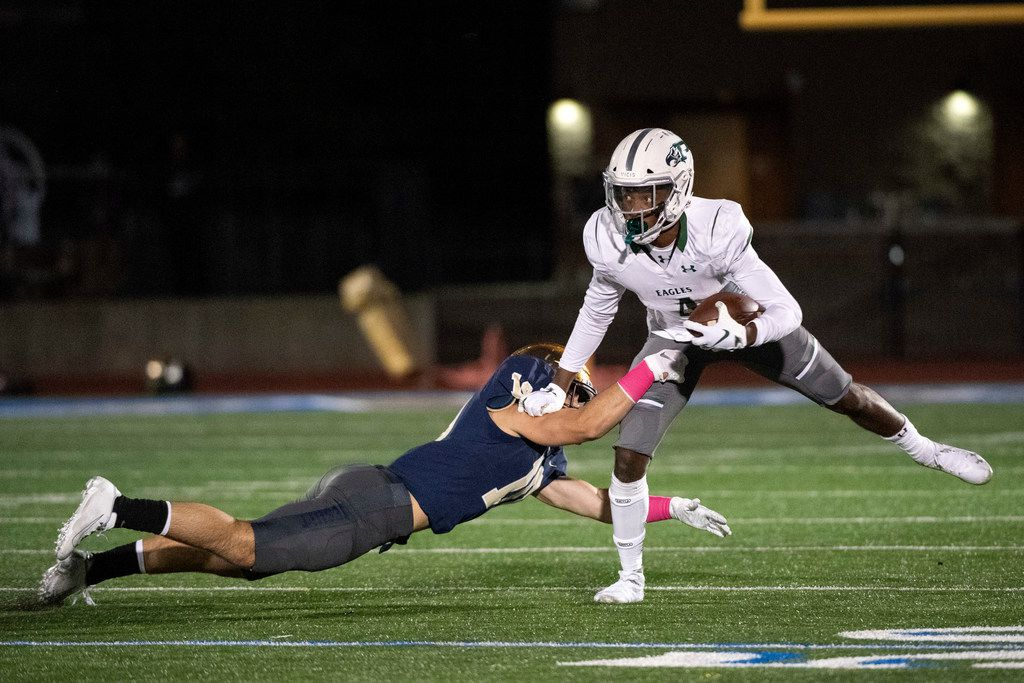 Prosper sophomore wide receiver Tyler Bailey (4) escapes the tackle of Jesuit senior linebacker Mitchell Campbell (10) in the first half of a high school football game on Friday, October 11, 2019 at Postell Stadium in Dallas. (Jeffrey McWhorter/Special Contributor)