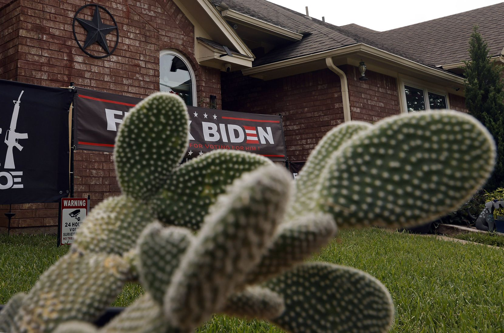 Three signs featuring expletives aimed at President Joe Biden and Vice President Kamala Harris have irked a Grapevine neighborhood. The signs in front of William Vitalec's house are photographed, Thursday, July 29, 2021.