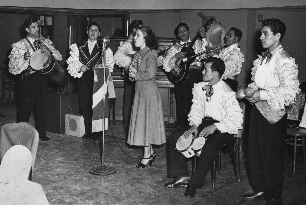 In 1940, the Joe Azcona Band performs in costume with a female guest singer.  The band was well-known in the 40s and performed at different area venues and the El Fenix Ballroom.