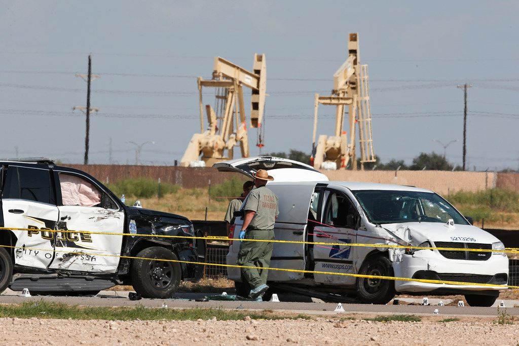 Law enforcement officials process the crime scene Sunday, Sept. 1, 2019, in Odessa.