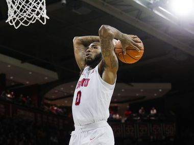 FILE - SMU guard Tyson Jolly (0) goes up for a dunk during the first half of a game against Wichita State on Sunday, March 1, 2020, at Moody Coliseum in University Park.