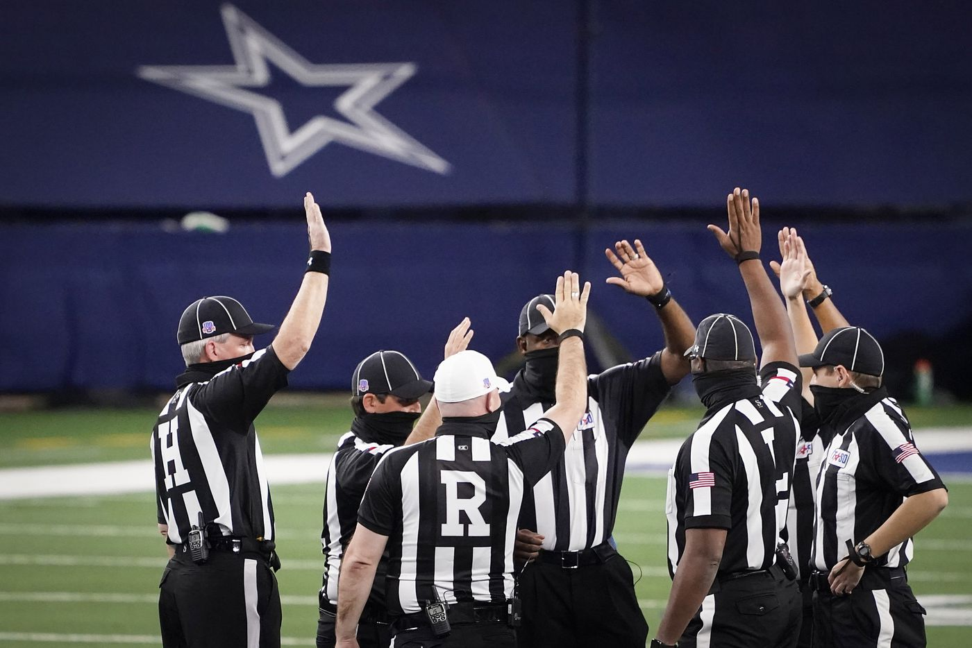 Officials huddle before the Class 5A Division I state football championship game between Denton Ryan and Cedar Park at AT&T Stadium on Friday, Jan. 15, 2021, in Arlington, Texas. (Smiley N. Pool/The Dallas Morning News)