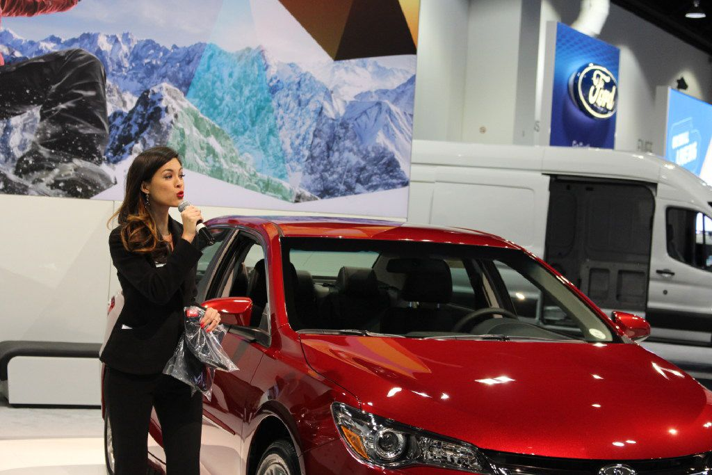 Isabelle Du, a Production Plus employee, talks about a Toyota at the Denver Auto Show in April, 2017.