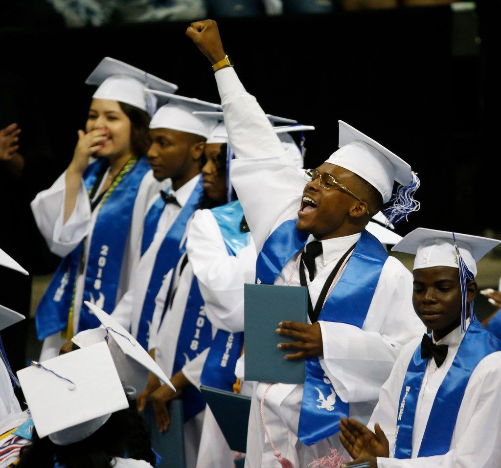 A graduate pumps his fist during the Wilmer-Hutchins High School graduation at Ellis Davis Field House in Dallas on June 2, 2018. (Nathan Hunsinger/The Dallas Morning News)