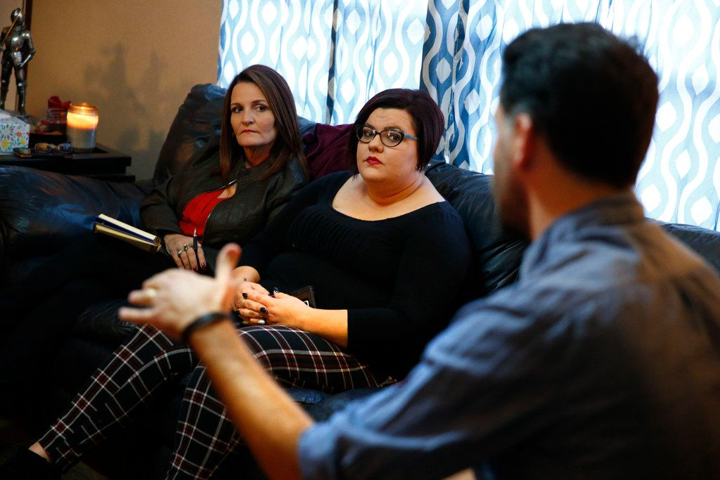Deanna Staton (left) and Kati Wall listen to one of their lawyers, Jamal Alsaffar, at Kati's house in Floresville, Texas on Nov. 29, 2017. The sisters lost their grandparents/parents Dennis and Sara Johnson during the shooting at First Baptist Church of Sutherland Springs on Nov. 5, 2017. The family is one of several who has decided to file a complaint against the U.S. Air Force for negligence connected to the shooting.  (Nathan Hunsinger/The Dallas Morning News)