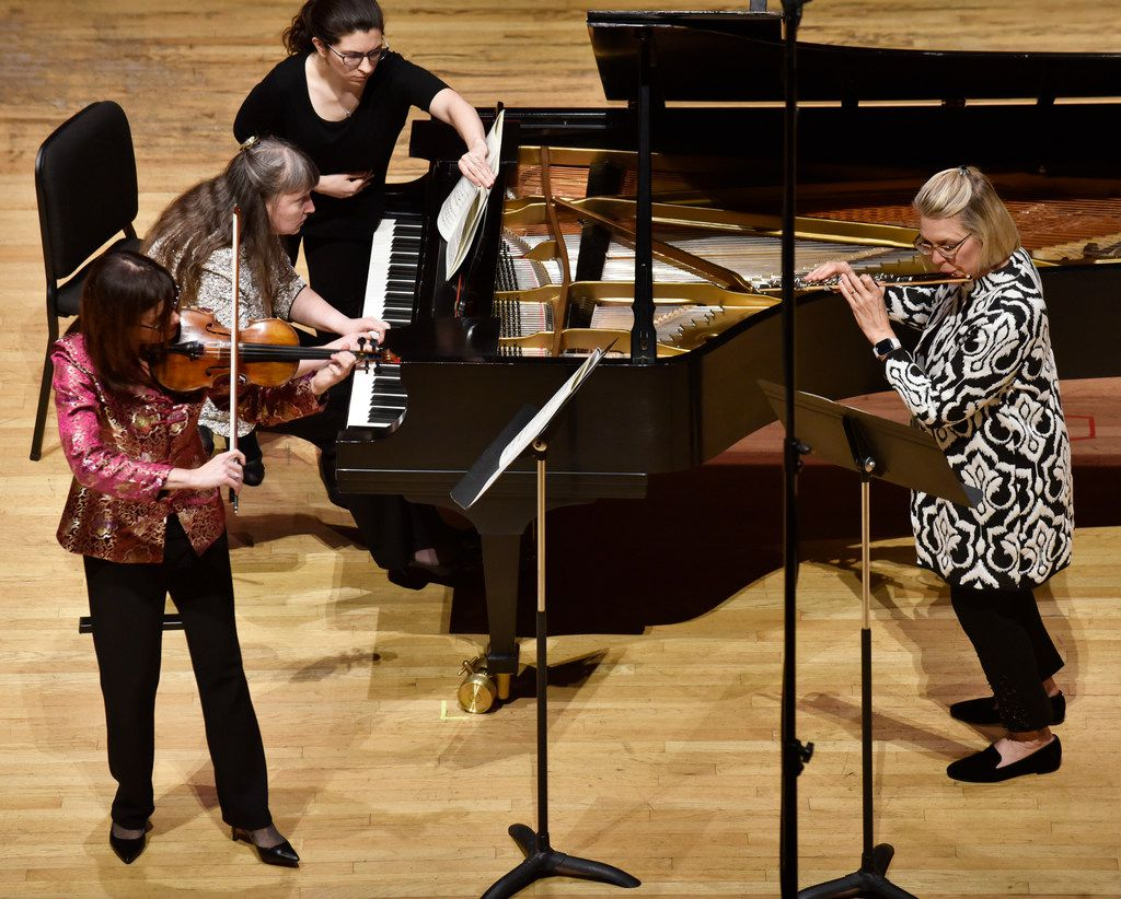 Violinist Maria Schleuning, pianist Liudmila Georgievskaya and flutist Helen Blackburn perform  Trio for flute, violin and piano (1958) by Nino Rota during a concert by Voices of Change Contemporary Chamber Music Ensemble on Feb. 4, 2019, on the campus of Southern Methodist University in Dallas.