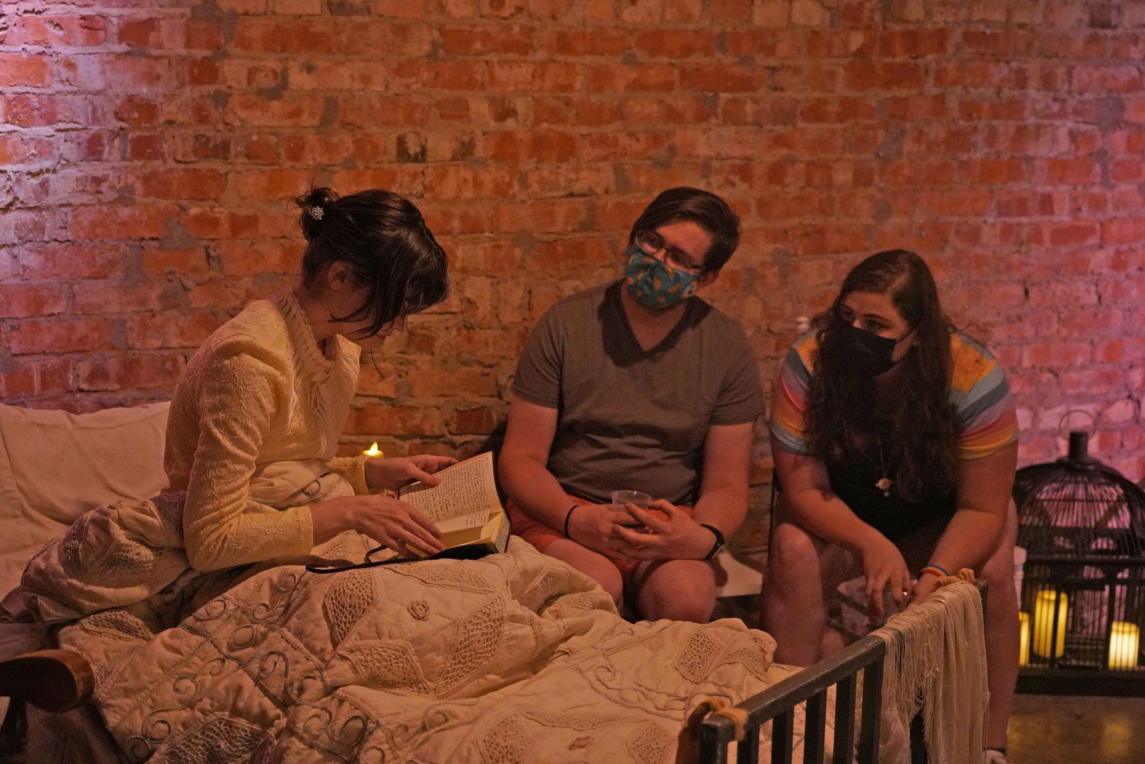 """Audience members at Cry Havoc Theater Company's """"Committed: Mad Women of the Asylum"""" were encouraged to move around the performance space to get a closer look at the actors in action."""