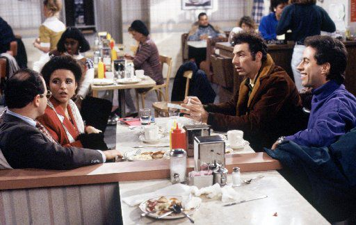 Jason Alexander as George Costanza, Julia Louis-Dreyfus as Elaine Benes, Michael Richards as Kramer and Jerry Seinfeld as Jerry Seinfeld in NBC's Seinfeld.
