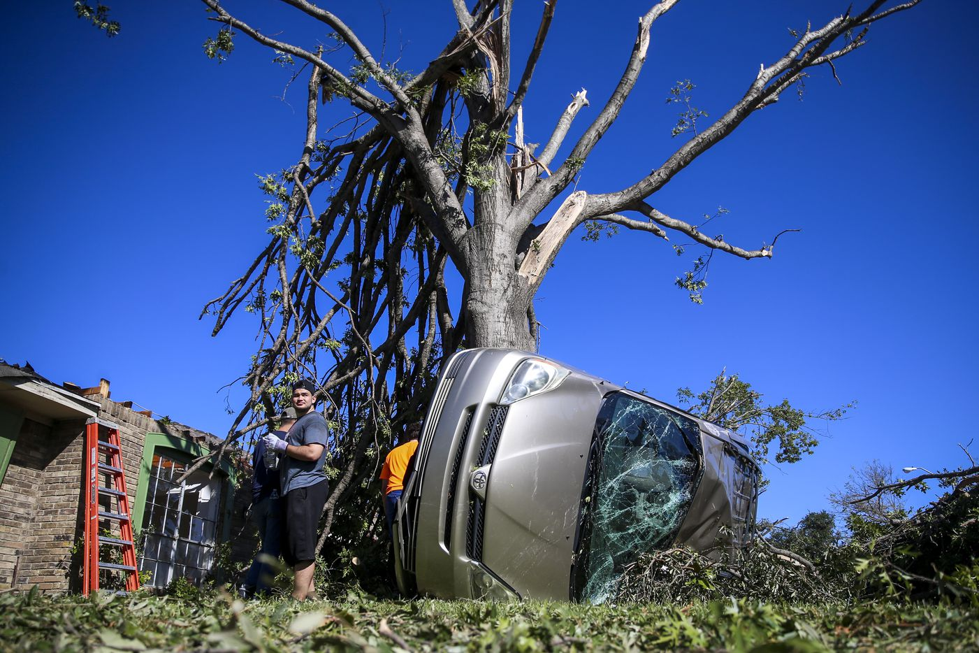 Members of Texas Baptist Men and Islamic Relief USA clear tornado debris on Monday, October 21, 2019 in Richardson, Texas.