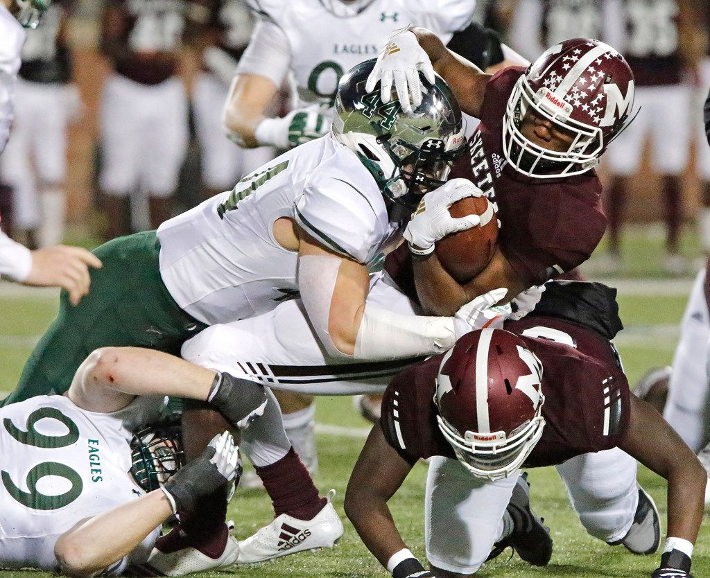 Mesquite High School running back Ladarius Turner (4) is tackled by Prosper High School linebacker Aidan Siano (44) during the first half as Prosper High School hosted Mesquite High School in a Class 6A Division I area-round playoff game at Eagle Stadium in Allen on Friday night, November 22, 2019. (Stewart F. House/Special Contributor)