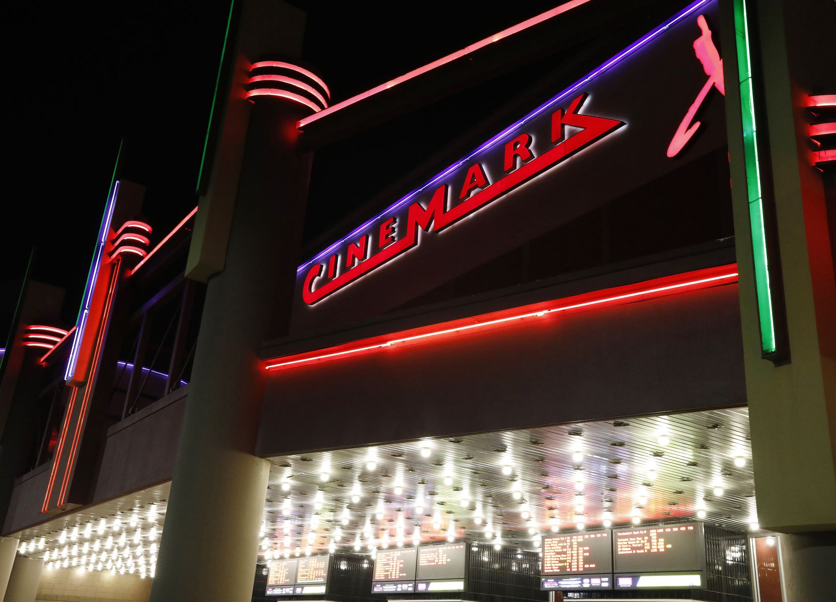 The Cinemark Tinseltown Grapevine and XD glows against a dark sky. Plano-based Cinemark's revenue is down nearly $2 billion on the year.