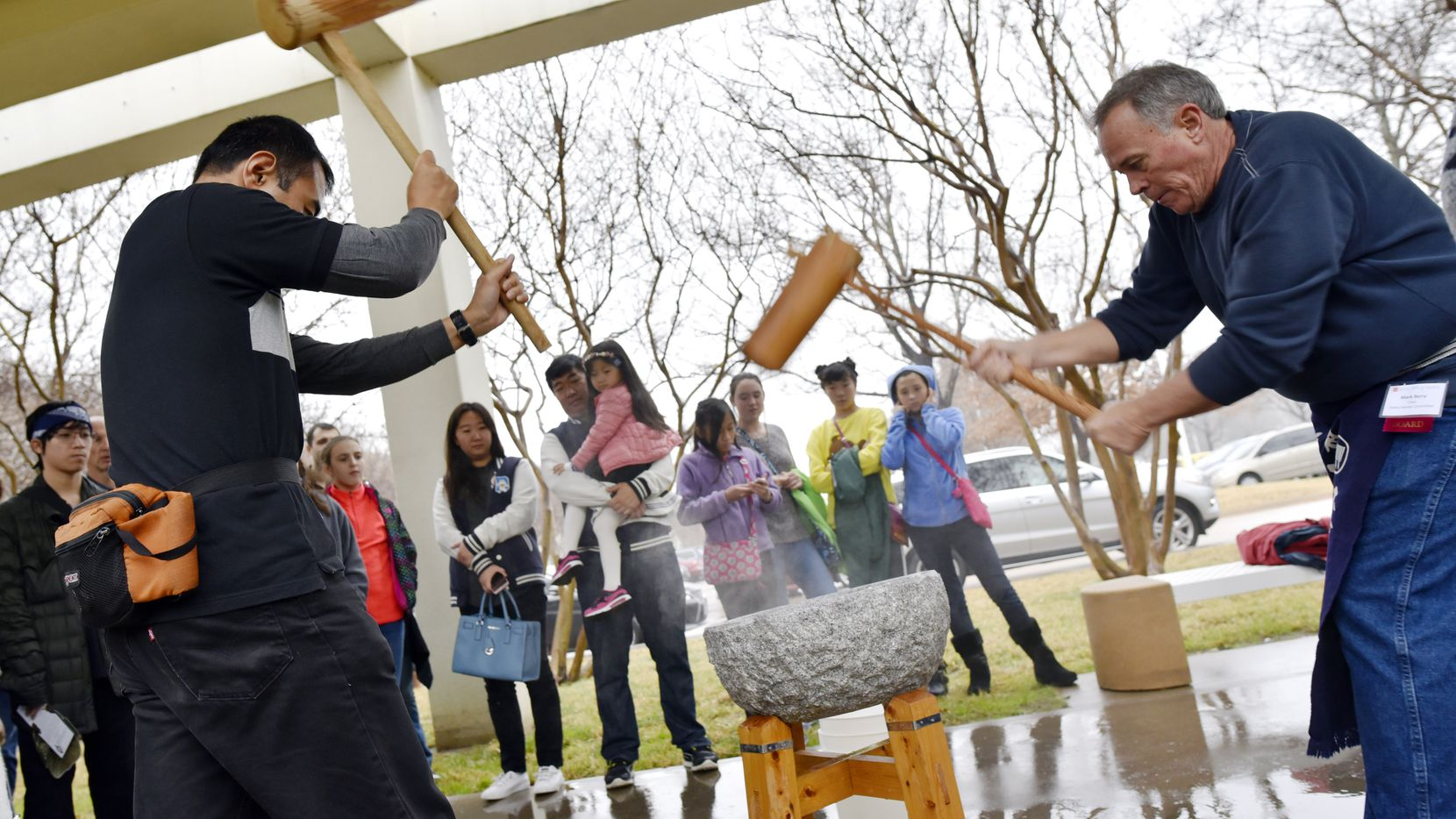 Naoki Hariyama, 46, left, and Mark Berry, 56, right, perform a rice pounding called mochitsuki at the Mochitsuki New Year's celebration, hosted by the Japan America Society of D-FW.