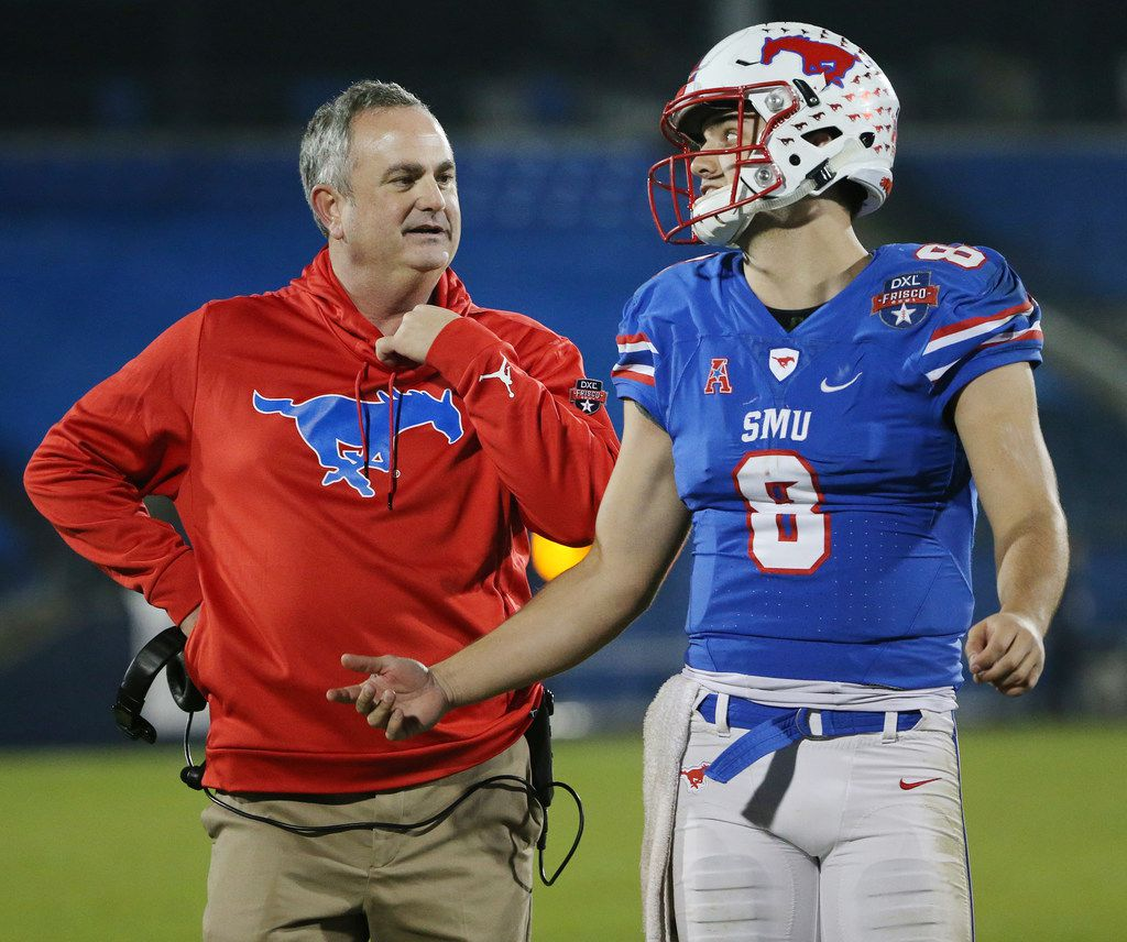 New Southern Methodist Mustangs head coach Sonny Dykes and quarterback Ben Hicks (8) speak in the second half during the NCAA 2017 DXL Frisco Bowl between the Louisiana Tech Bulldogs and the SMU Mustangs at Toyota Stadium in Frisco, Texas Wednesday December 20, 2017. Louisiana Tech Bulldogs won 51-10. (Andy Jacobsohn/The Dallas Morning News)