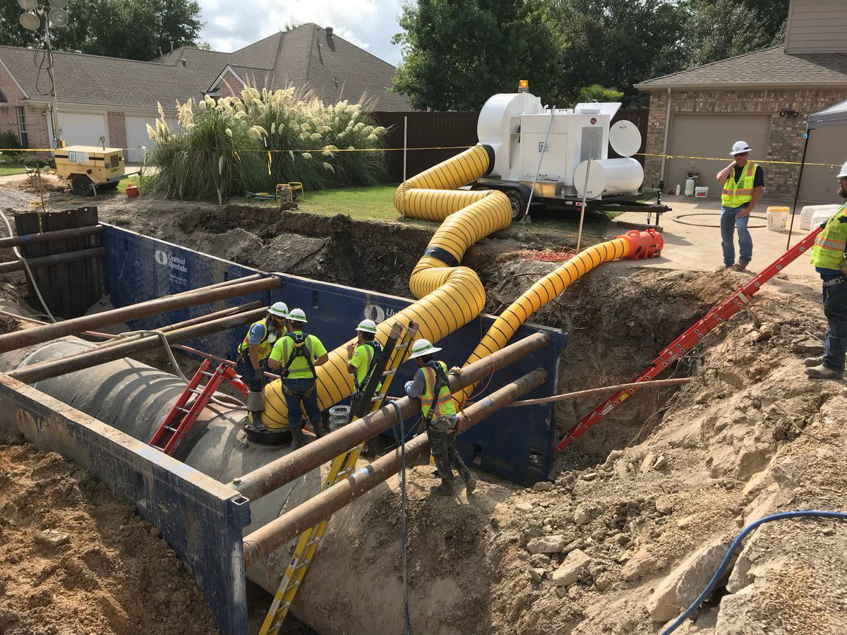 Workers repair a water pipeline that broke in Richardson on Thursday. It was back in service Monday evening.