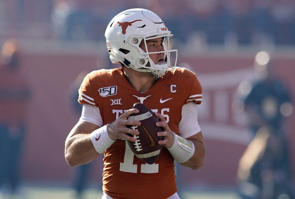 Texas' Sam Ehlinger (11) looks to pass against Kansas State during the first half of an NCAA college football game in Austin, Texas, Saturday, Nov. 9, 2019. (AP Photo/Chuck Burton)