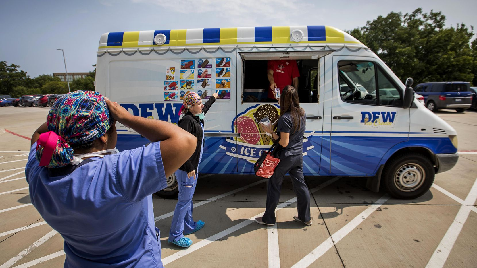 Key-Whitman Eye Center staffers took a break to visit the ice cream truck brought in to treat employees in the parking lot of the surgery center in 2018.