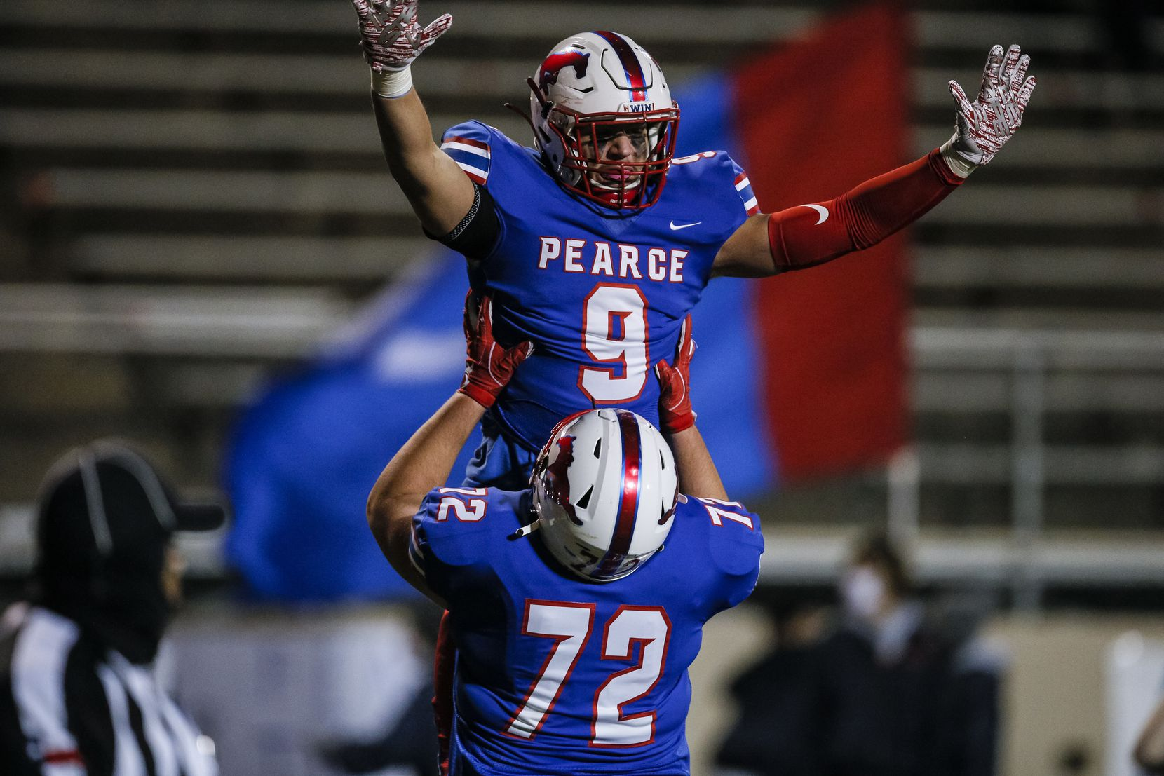 JJ Pearce senior halfback Dylan Adams (9) is lifted into the air by junior offensive lineman Canyon Wadsworth (72) in celebration after scoring a touchdown during the first half of a high school playoff football game against Irving MacArthur at Eagle-Mustang Stadium in Richardson, Thursday, December 3, 2020. (Brandon Wade/Special Contributor)