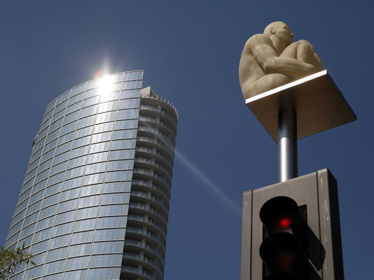 In this Aug. 9, 2012, photo, light reflects of of the Museum Tower as seen just outside the Nasher Sculpture Center in Dallas.