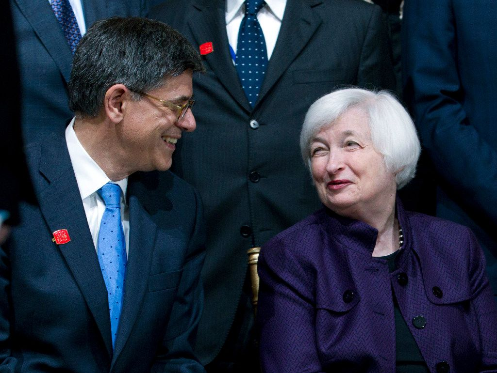 Treasury Secretary Jacob Lew speaks with Federal Reserve Chair Janet Yellen at the G-20 group photo, during the World Bank/IMF Annual Meetings at IMF headquarters in Washington, Thursday, Oct. 6, 2016.