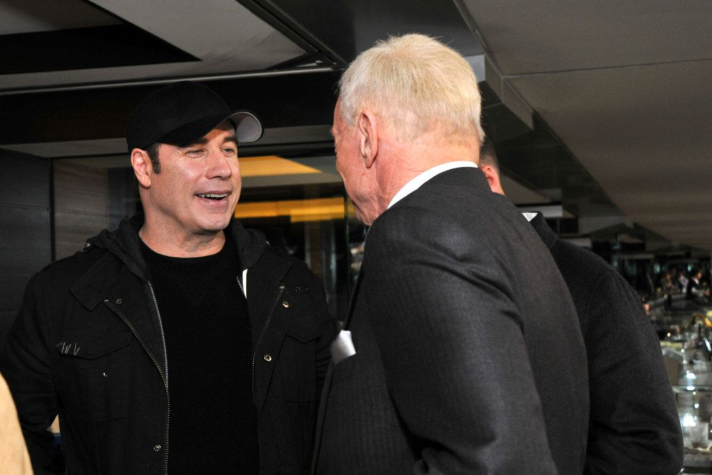 John Travolta talks with Jerry Jones in the Jones suite at AT&T Stadium during Super Bowl XLV on Feb. 6, 2011. (Photo is property of the Dallas Cowboys. Permission to publish required.)