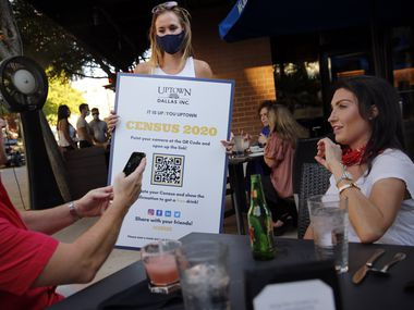 Uptown Dallas volunteer Christie Myers (center) encourages Darren Houck (left) and his friend Michelle Sloan (right) to register with Census 2020 outside Mi Cocina at West Village shopping center in Dallas, Thursday, August 20, 2020. Those who registered received free drinks onsite from Bubble Bus Co. (Tom Fox/The Dallas Morning News)