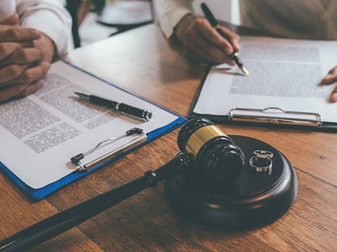 The mere filing of a divorce is not enough to trigger an automatic revocation.