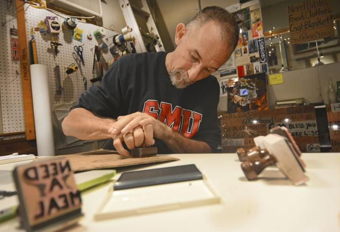 Willie Baronet plans  to use stamps inspired by the panhandlers' signs he has collected over the years to make jewelry. Baronet, an advertising professor at Southern Methodist University, has bought hundreds of signs used by panhandlers to ask for food and money.