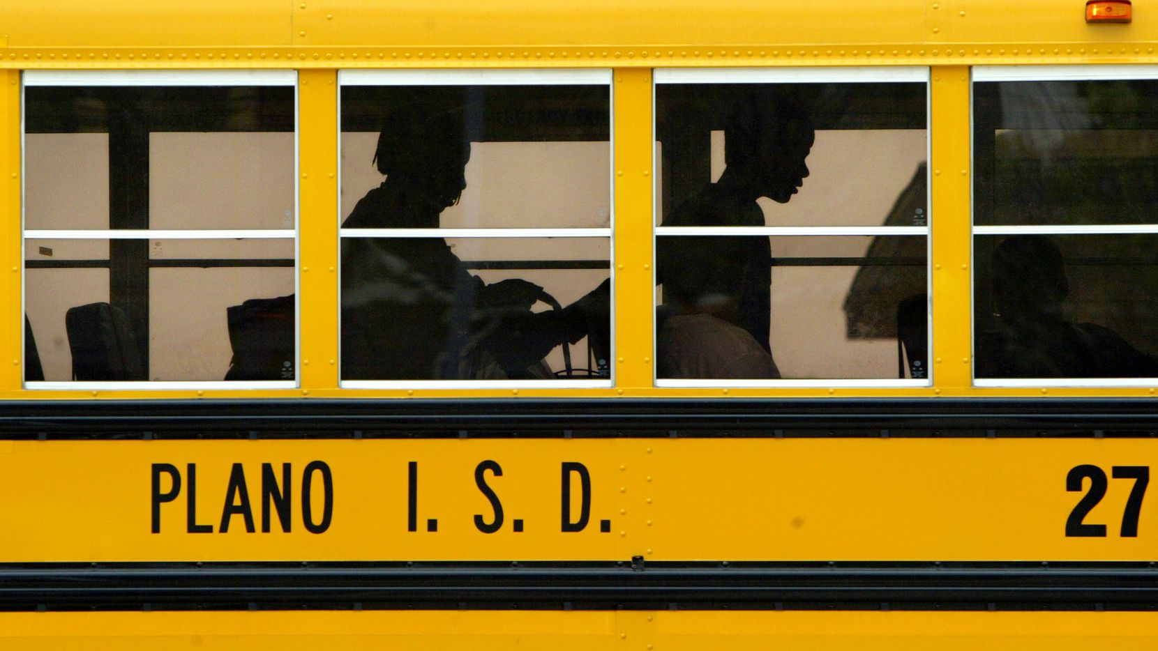 A Plano ISD school bus is pictured in this file photo. The school district has canceled classes Wednesday as North Texas braces for more snow.