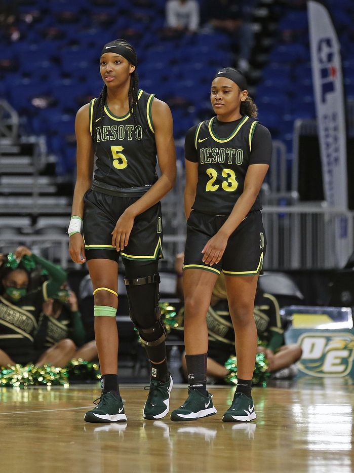 DeSoto Sa'Myah Smith #5 and DeSoto Kendall Brown #23 enter the floor to start the game against Cypress Creek.DeSoto vs. Cypress Creek girls basketball Class 6A state championship game on Thursday, March 12, 2021 at the Alamodome.