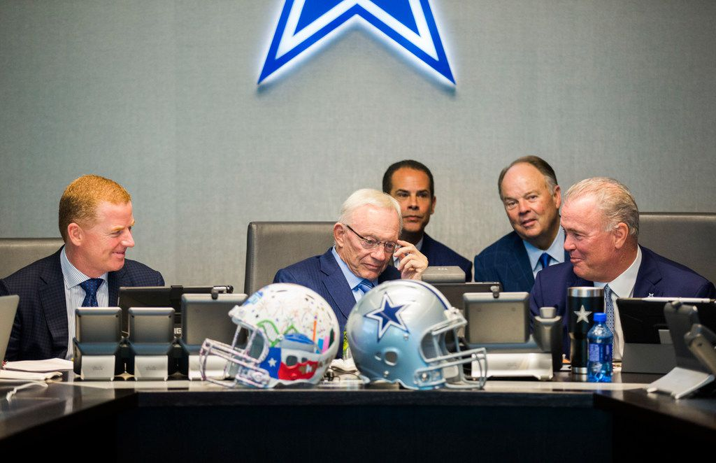 Dallas Cowboys Owner Jerry Jones, center, Head Coach Jason Garrett, left, CEO and Executive Vice President Stephen Jones, right, and other Cowboys executives wait to make their first round pick in the war room on Thursday, April 26, 2018 at The Star in Frisco, Texas. (Ashley Landis/The Dallas Morning News)