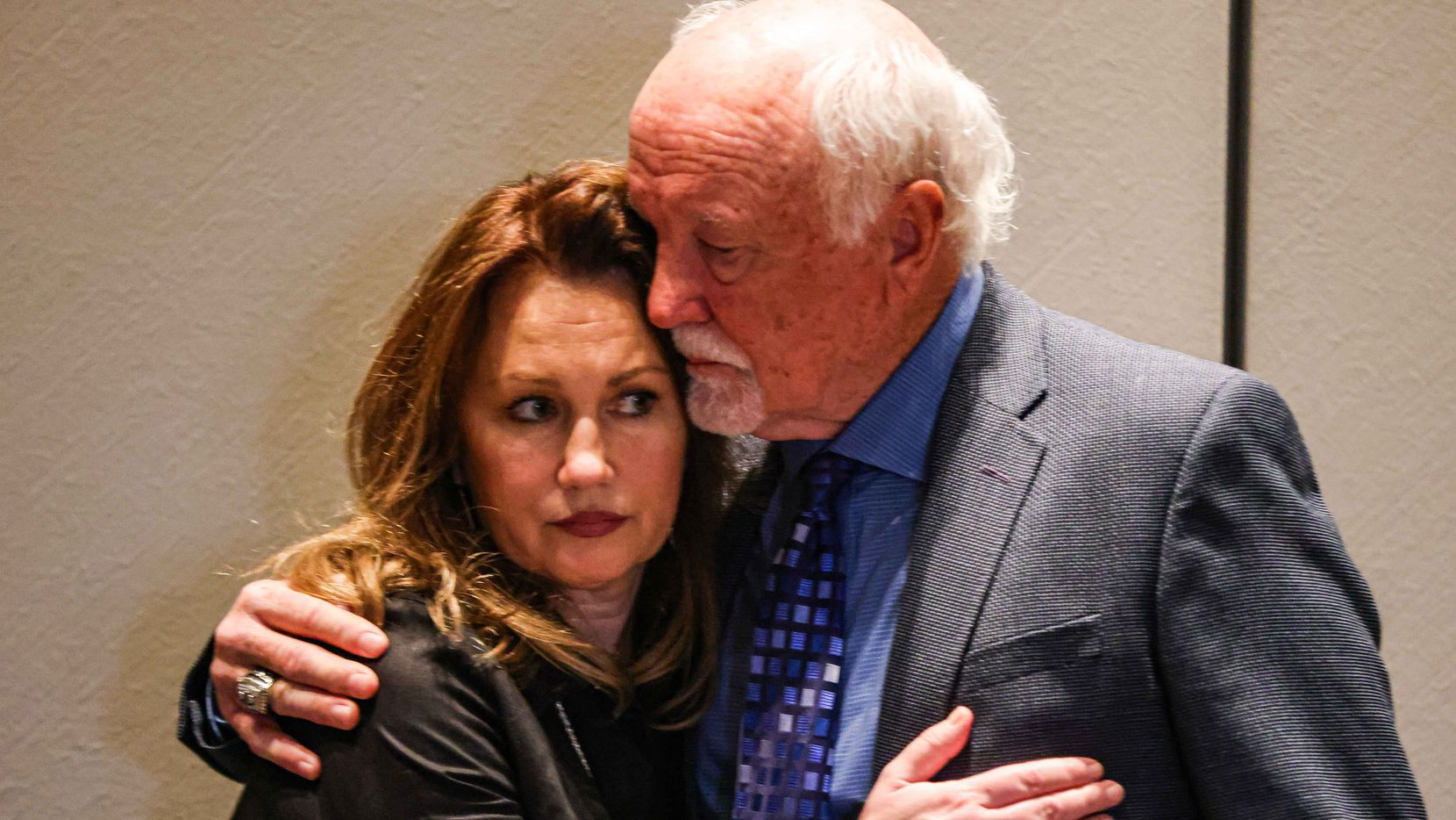 Cliff Harris, former Dallas Cowboys safety, 2020 NFL HOF, holds his wife, Karen Harris, after a press conference with families who say their mothers were killed by Billy Chemirmir, to promote legislation filed which they say will help improve security at senior living communities in Plano on Wednesday, March 10, 2021.