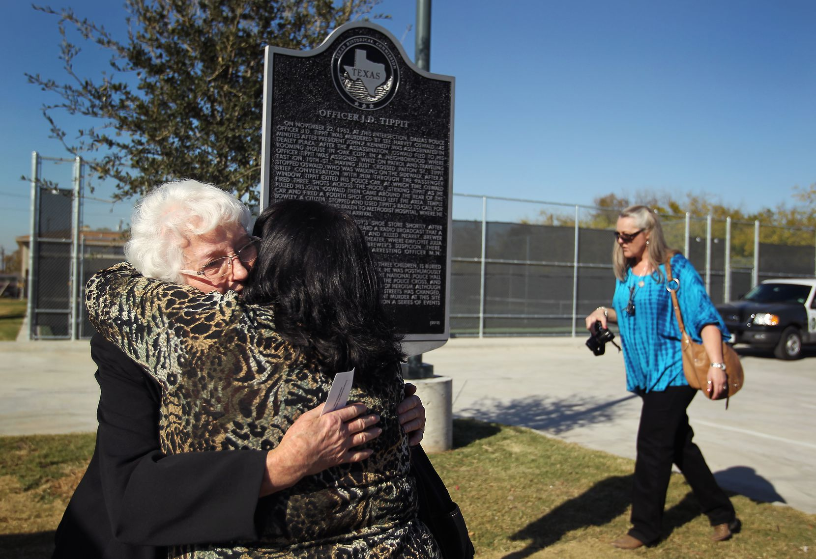 Marie Tippit hugged her daughter, Brenda Tippit, following the dedication ceremony for the historical marker for J.D. Tippit in Oak Cliff in 2012.