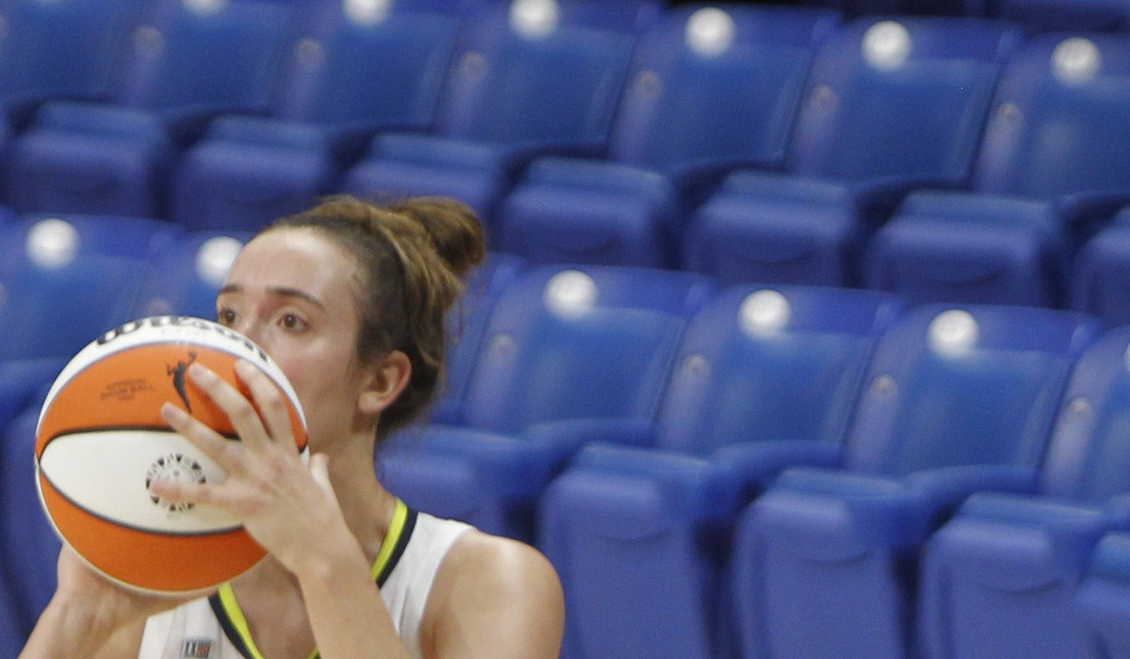 Dallas Wings guard Marina Mabrey (3) eyes the basket before launching an uncontested 3-pointer during first half action against Phoenix. The Dallas Wings hosted the Phoenix Mercury for their WNBA game held at UTA's College Park Center in Arlington on May 29, 2021.