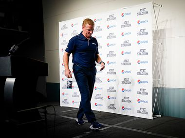 Dallas Cowboys head coach Jason Garrett walks away from the podium after addressing the media after a victory over the Washington Redskins in an NFL football game at AT&T Stadium on Sunday, Dec. 29, 2019, in Arlington.