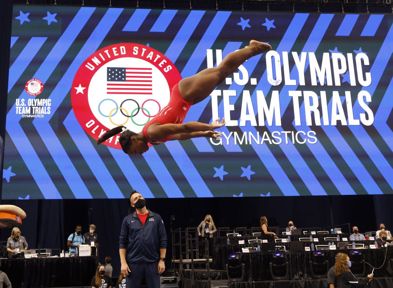 Simone Biles practices on the vault during stretch period on day 2 of the women's 2021 U.S. Olympic Trials at The Dome at America's Center on Saturday, June 27, 2021 in St Louis, Missouri.(Vernon Bryant/The Dallas Morning News)