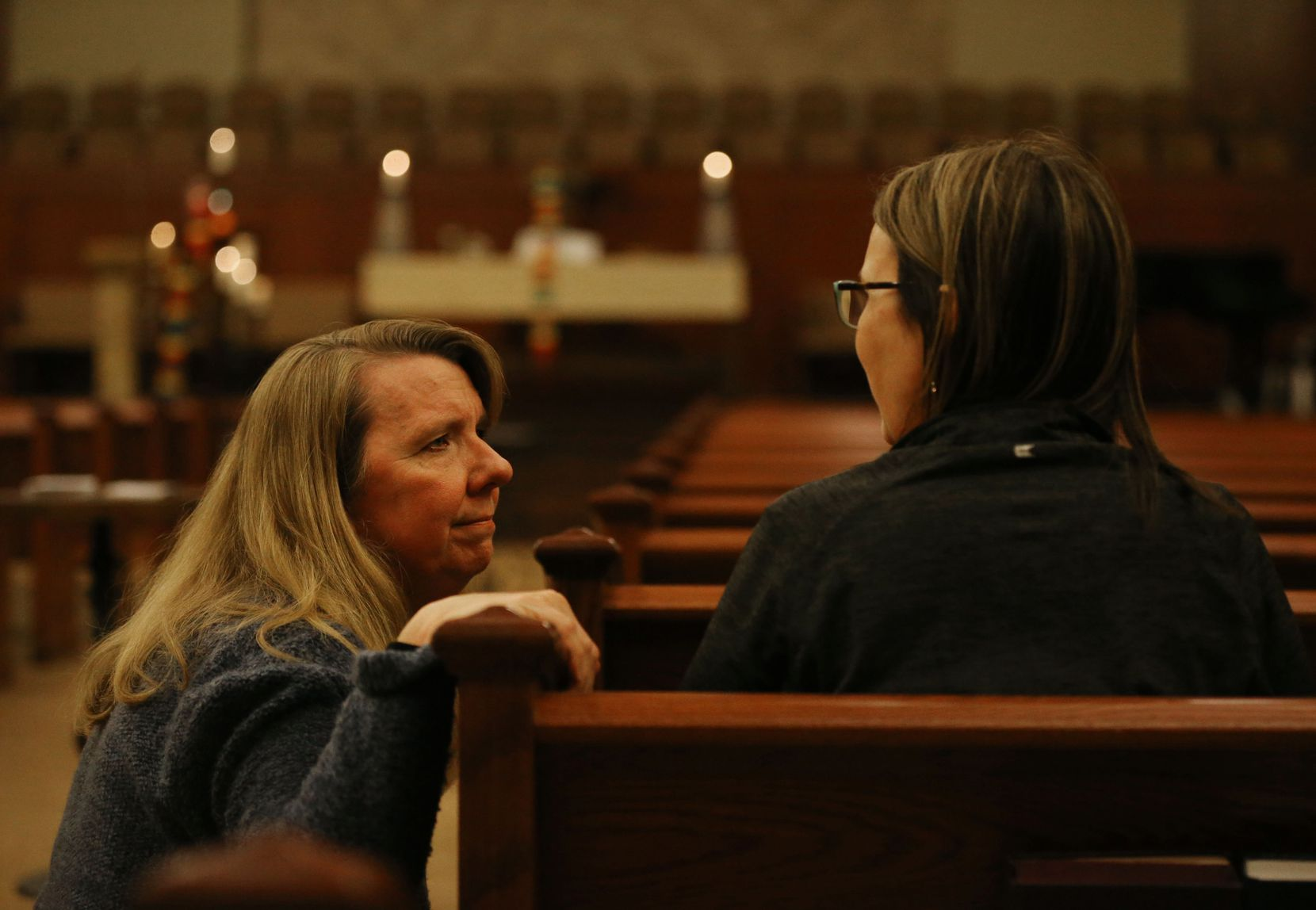 The Rev. Laura Echols-Richter (left) speaks with church member Tina McGarry in the sanctuary at Grace Avenue United Methodist Church in Frisco. The Frisco church opened its doors to prayers after the denomination's anti-LGBTQ vote in St. Louis on Tuesday.