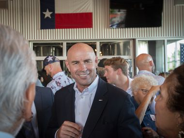 Congressional District 6 candidate Jake Ellzey talks with supporters during an evening fundraiser at Legal Draft in Arlington, Texas on July 14,, 2021. (Robert W. Hart/Special Contributor)