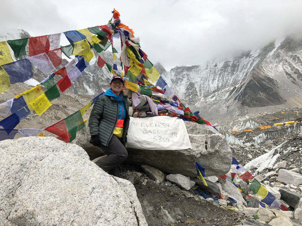 Writer Molly Sprayregen beams after reaching Everest Base Camp, which rests on a massive glacier at 17,600 feet in elevation. The hike took eight days.