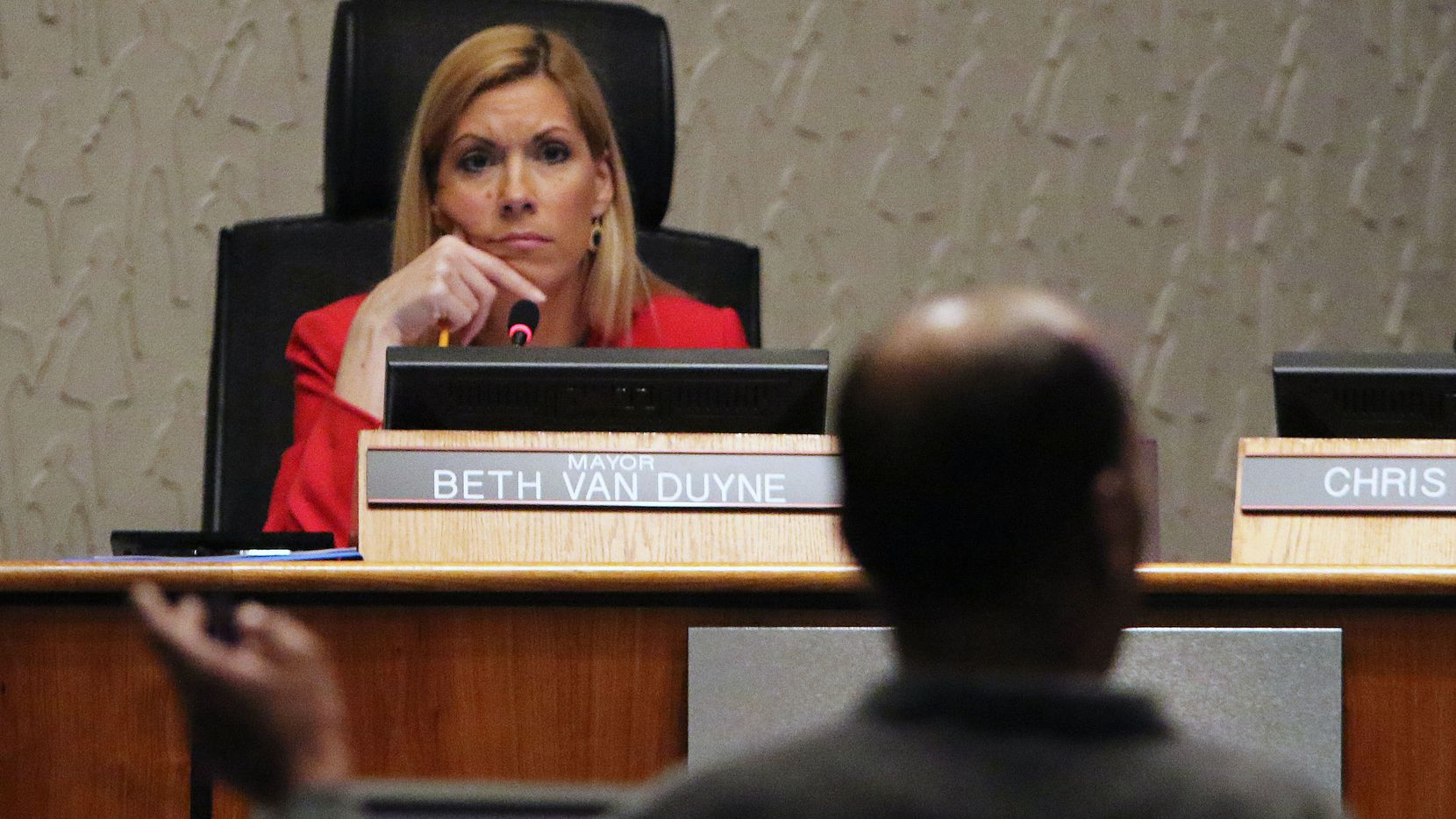 Irving Mayor Beth Van Duyne listens to a speech from Anthony Bond, founder of the Irving NAACP chapter, on legislation HB 562 during a city council meeting at Irving City Hall on Thursday, March 19, 2015 in Irving, Texas.  (Gregory Castillo/The Dallas Morning News)