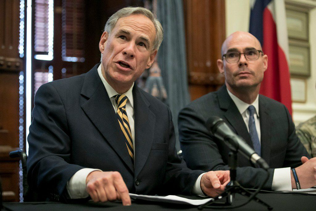 Gov. Greg Abbott announces a deployment of National Guard troops to the Texas-Mexico border at a news conference at the Capitol on Friday June 21, 2019.  Listening is House Speaker Dennis Bonnen, right.