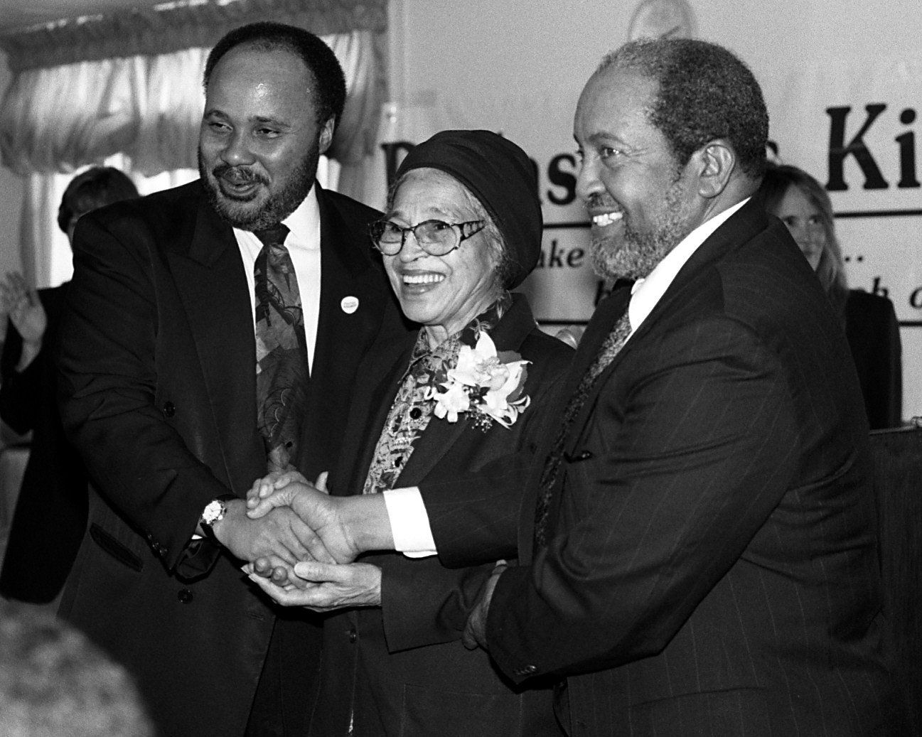 Martin Luther King III, Rosa Parks and Iman W. Deen Mohammed posed shaking hands after a Dallas Acts Kind news conference at St. Luke Community United Methodist Church. King is the son of Martin Luther King Jr. and Mohammed is the son of Elijah Mohammed, founder of the Nation of Islam. This was King and Mohammed's first meeting.