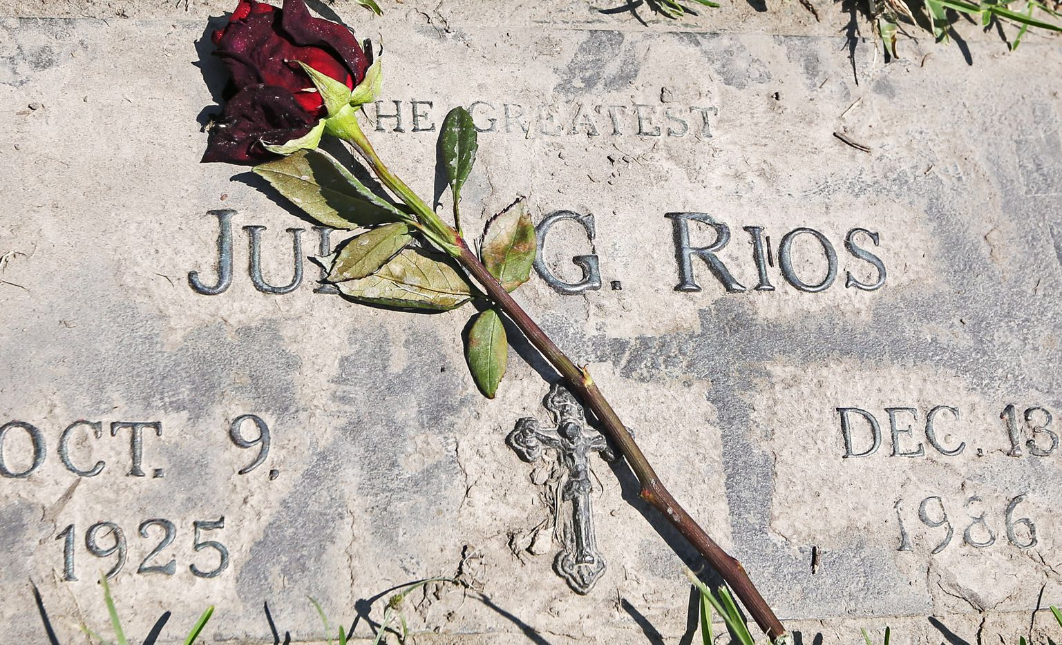Mud and debris from the floodwater is seen on a grave marker at Hollywood Cemetery near downtown Houston on Sunday, September 10, 2017.